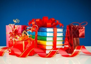 3183396-christmas-presents-with-stack-of-books-against-blue-background